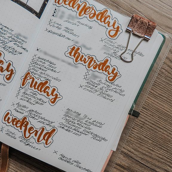 bullet journal weekly spread lettering